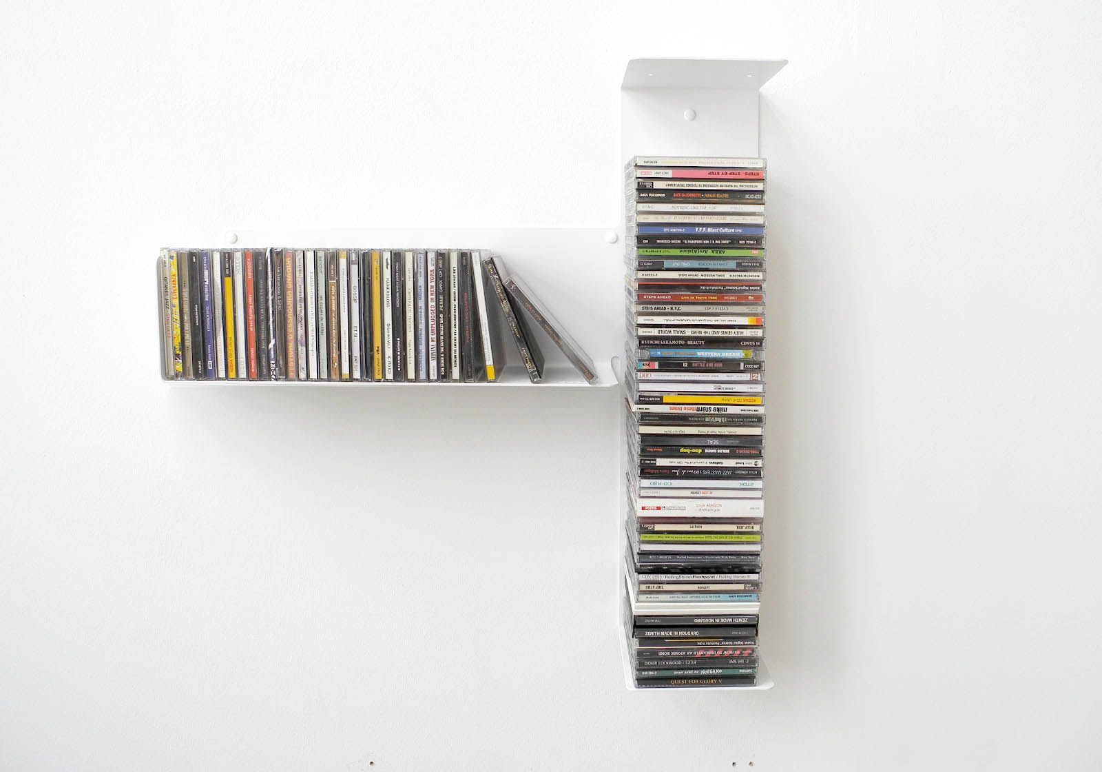 asymmetrical cd shelf t left. Black Bedroom Furniture Sets. Home Design Ideas